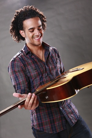 Young guitar player photo