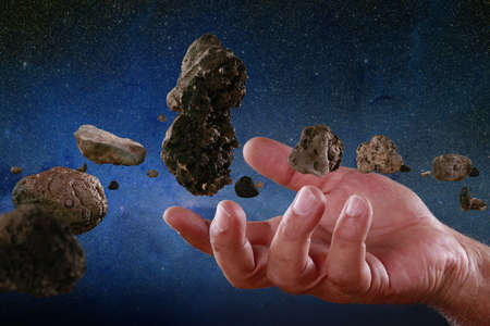 Asteroids at hand Stock Photo