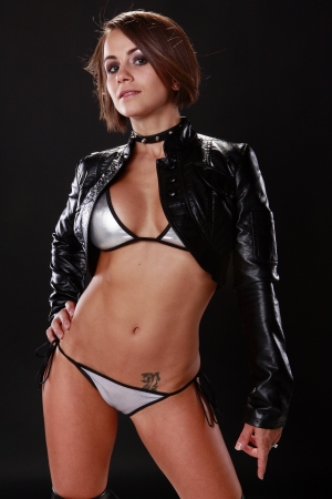Good looking brunette in silver bikini and leather jacket Stock Photo - 10083905