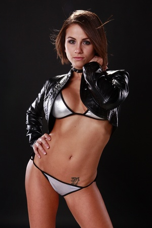 sexy black girl: Good looking brunette in silver bikini and leather jacket Stock Photo