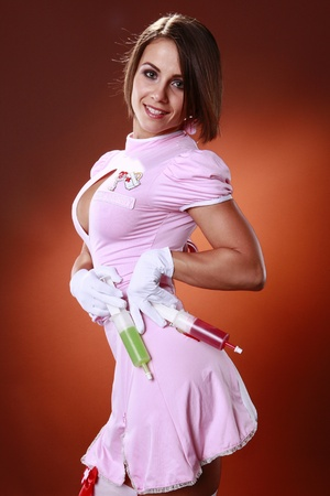 Sexy nurse and gelatin cocktail syringes photo