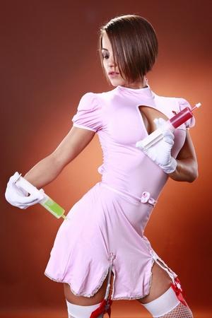 Sexy nurse and gelatin cocktail syringes photo