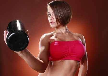 top: Fit woman and large wine bottle Stock Photo