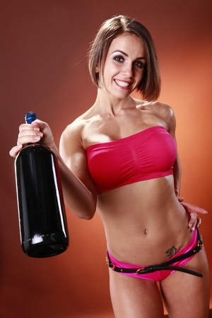 Fit woman and large wine bottle photo