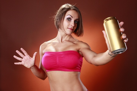 Fit brunette and a drink can photo