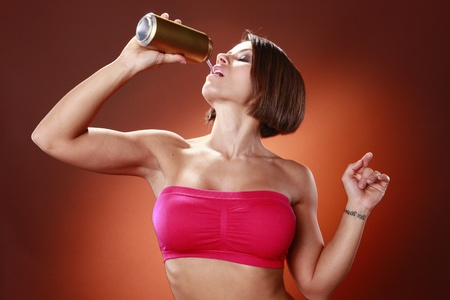 attitude girls: Fit brunette and a drink can Stock Photo