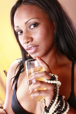 sexy african american woman: Cute Caribbean young woman and a glass of cold wine Stock Photo