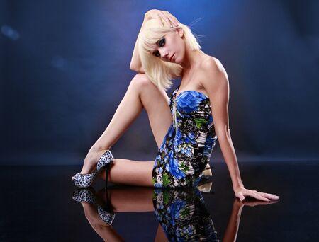 Cute European blond on a mirror floor Stock Photo - 10407505