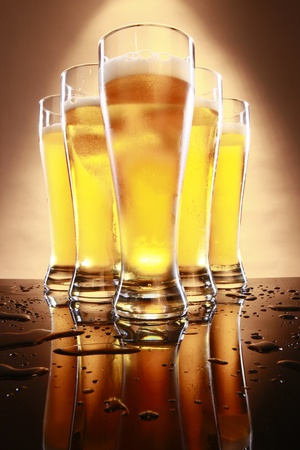 bar counter: Cold beer in tall glasses Stock Photo