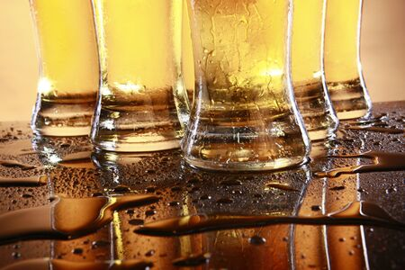 Cold beer in tall glasses photo