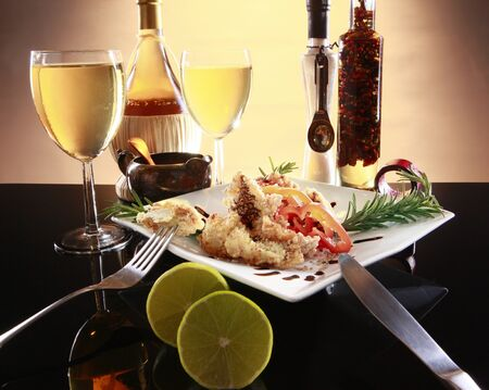 Battered fish or chicken, wine and spices Banque d'images