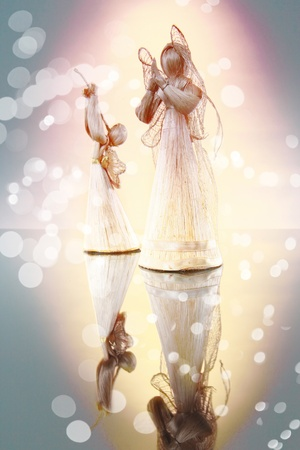 angel figurine: Straw angels and mirror image