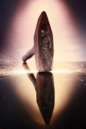 Wide angle and reflection of a forging hammer photo
