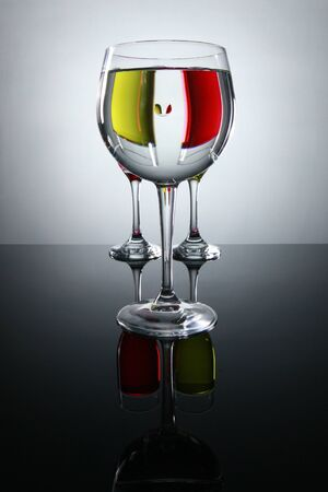 Prismatic view of red and white wine