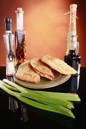 Deep fried empanadas, wine, and spices