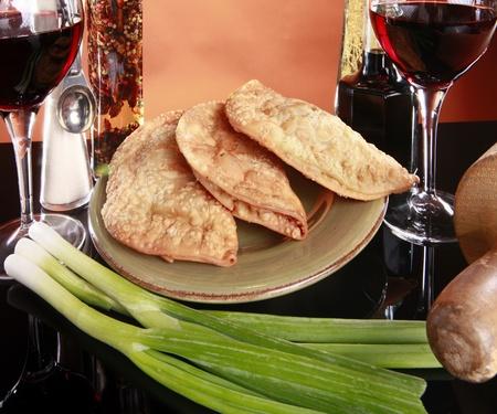 Deep fried empanadas, wine, and spices photo