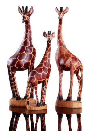 Wood carved family of miniature giraffes isolated photo