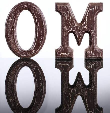 The letters O and M and their mirror image photo