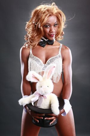 Sexy magician and her bunny act photo