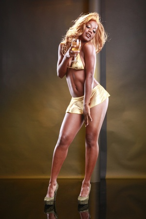 Golden girl and wine Stock Photo - 10824650