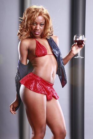 Gorgeous AA sips red wine photo