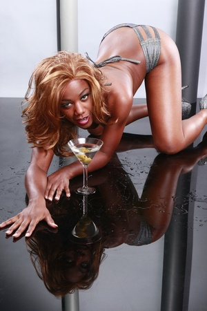 woman mirror: Silver bikini, cold martini and wet mirror image
