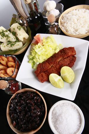 caribbean food: Breaded fish and staple caribbean sides