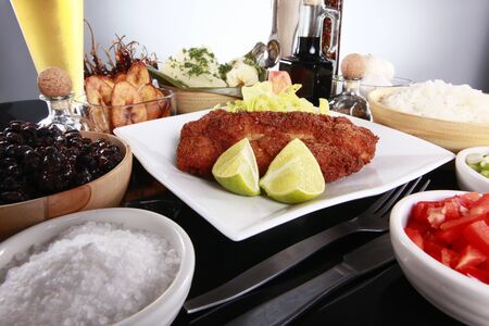 yucca: Breaded fish with staple caribbean sides, rice and beans