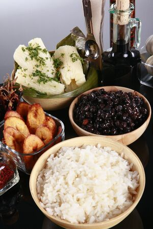 the sides: Staple latino sides, manioc, rice, plantains, and black beans