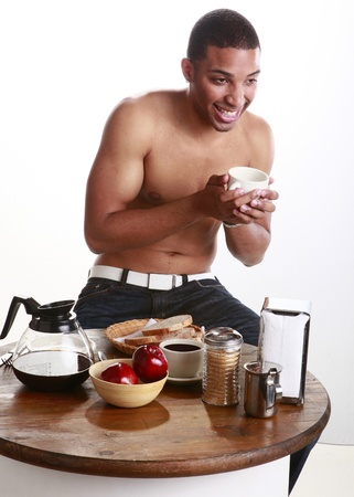 Young man has a cup of coffee Stock Photo - 11056670