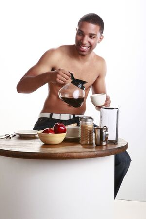 Young man has a cup of coffee photo