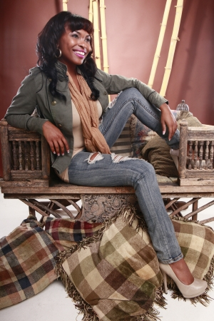 foyer: Young African American on a vintage oriental chair