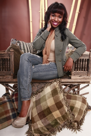Young African American on a vintage oriental chair photo