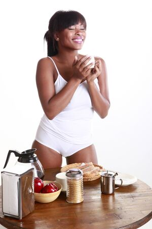 Young African American enjoys a morning coffee photo