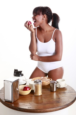 Young African American has an apple for breakfast photo