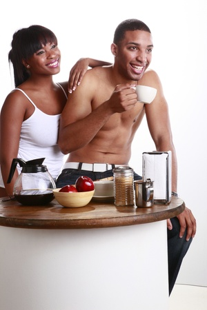 Young African American couple have fun and breakfast photo