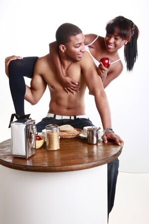 pantry: Young African American couple have fun and breakfast