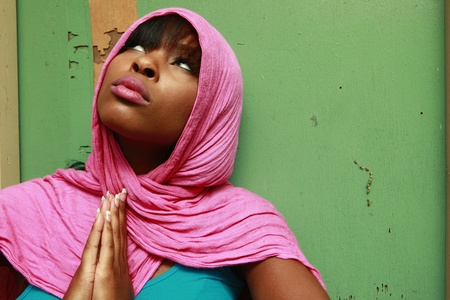 religious clothing: Young woman wearing a scarf Stock Photo