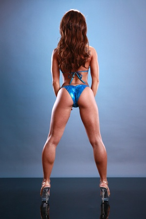 Fitness poses on blue photo