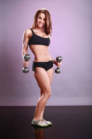 female muscle: Fitness models dumbbell routine