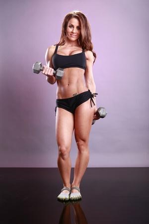Fitness model's dumbbell routine Stock Photo - 11553034