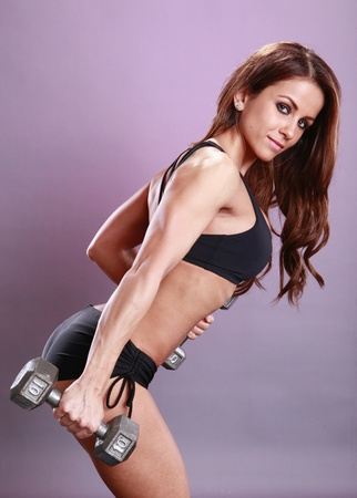 Fitness models dumbbell routine photo