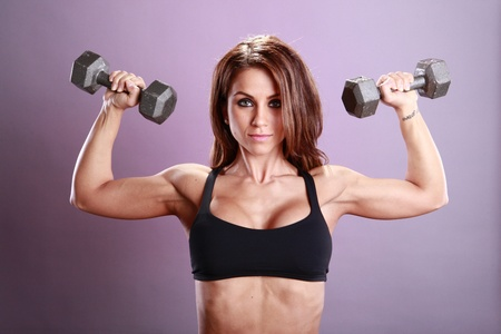 Fitness model's dumbbell routine Stock Photo - 11553136