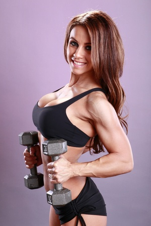 Fitness model's dumbbell routine Foto de archivo