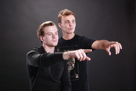 cocky: Two young men pointing fingers Stock Photo