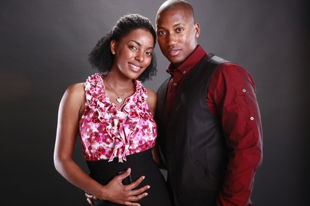 Young african american couple on black Stock Photo - 11553092