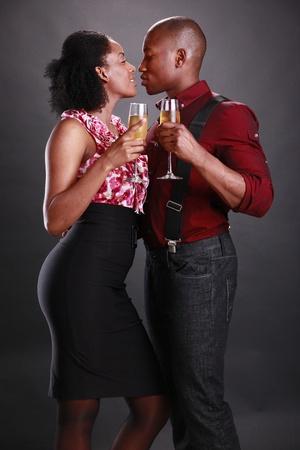 An african american couple cheers with champagne flutes Reklamní fotografie - 11553090