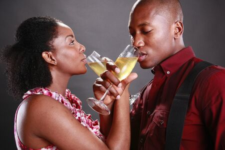 An african american couple cheers with champagne flutes