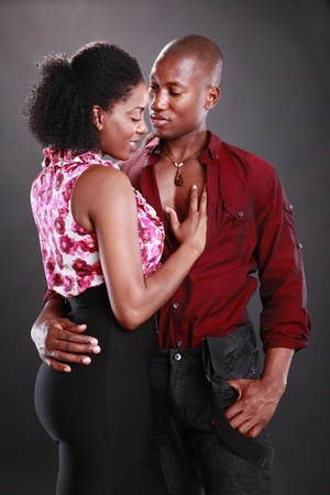 Young african american couple on black photo