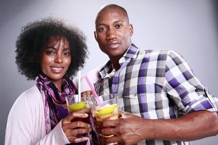Young couple and Manhattan Ice Tea 版權商用圖片